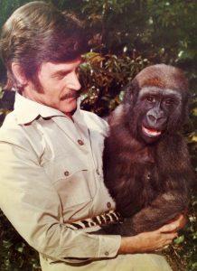 John Goddard holds a primate.