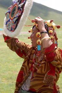 Tibetan women dons hat.